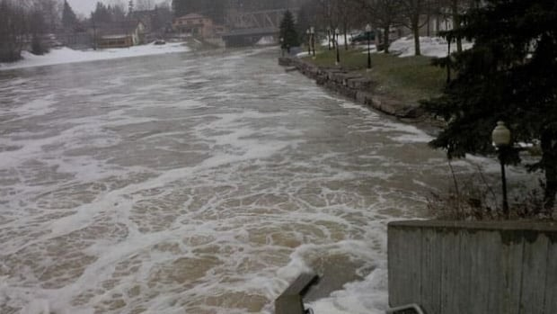 The Nith River is seen bursting its banks in New Hamburg in 2013. The Grand River Conservation Authority is warning mild temperatures and rain this week will increase the water levels in the river.