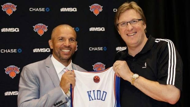 Jason Kidd poses with his new Knicks sweater, and his new boss, Glen Grunwald, at a press conference on Thursday. Two days later, Kidd is facing a DUI charge.