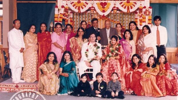 Asha Goel, in the pink sari, is photographed with her extended family. Subhash Agrawal, in the black suit in the centre of the photo, is on the right of his older brother Suresh Agrawal.