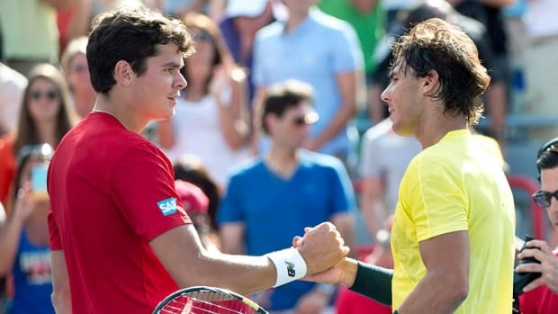 Canada's Milos Raonic, left, congratulates Rafael Nadal of Spain for winning the final at the Rogers Cup tennis tournament in Montreal on Sunday.