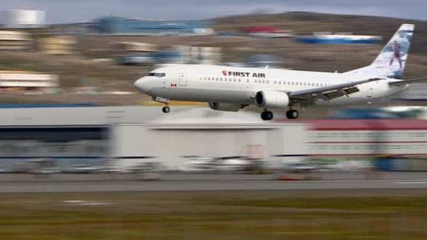 A First Air 737-400 plane lands in Iqaluit