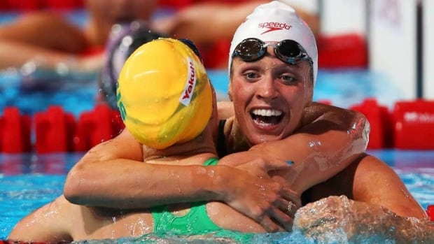 Bronze medallist Hilary Caldwell of Canada, right, hugs second-place finisher Belinda Hocking after the women's backstroke 200-metre final at the FINA world championships at Palau Sant Jordi on Saturday in Barcelona, Spain.
