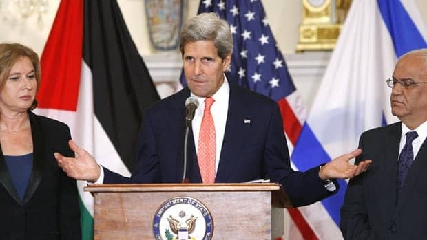 U.S. Secretary of State John Kerry, centre, announces further peace talks at a news conference with Israel's justice minister, Tzipi Livni, left, and chief Palestinian negotiator Saeb Erekat at the State Department in Washington Tuesday. The two sides will meet again before mid-August.