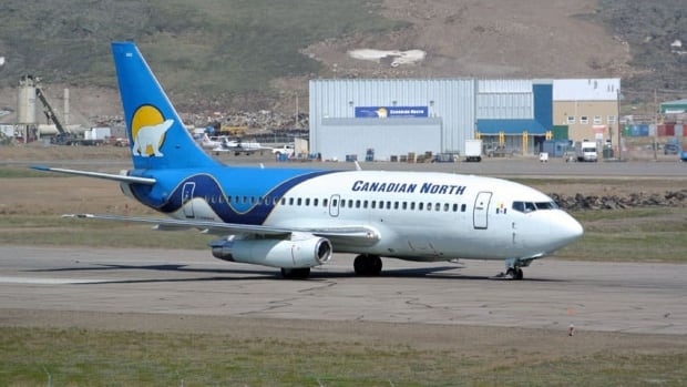 "A Canadian North 737 taxis at the Iqaluit airport. First Air and Canadian North have announced they will now ""codeshare"" some routes, selling seats and cargo space on the other airline's flights."