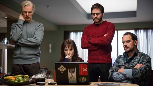 The dramatic thriller The Fifth Estate, which looks at the rise of WikiLeaks, stars Benedict Cumberbatch, left, as its controversial founder Julian Assange and Daniel Bruhl, second right, as his colleague Daniel Domscheit-Berg.