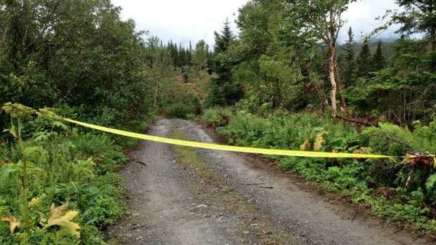 Police tape blocks off access to the cabin, near Wiltondale, that caught fire on Tuesday and could contain human remains.