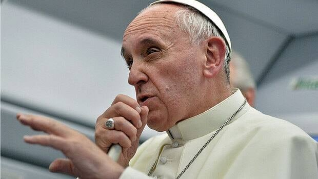 Pope Francis talks with journalists as he flies back to Rome following his visit to Brazil on July 29, 2013.