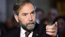 Tom Mulcair, Joe Oliver battle over energy policy
