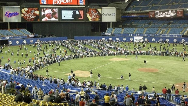"Fans fill the outfield at Olympic Stadium prior to the Expos' final game on Sept. 29, 2004, against Florida. Some fans are hoping a major league team returns to Montreal. The Blue Jays will play their final two pre-season games next spring at the ""Big O"" against the New York Mets."