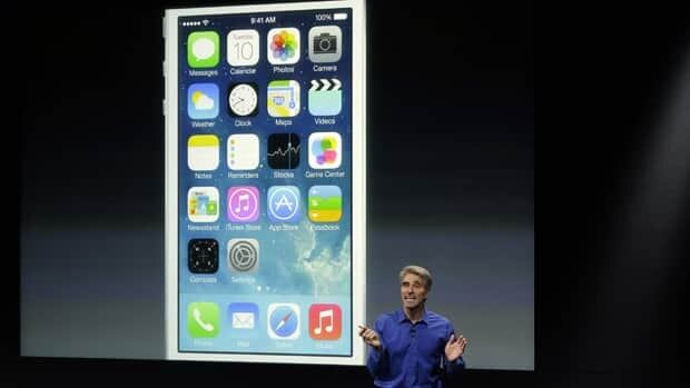 Craig Federighi, senior vice president of software engineering at Apple, speaks about the new iOS 7 release in Cupertino, Calif., on Tuesday.