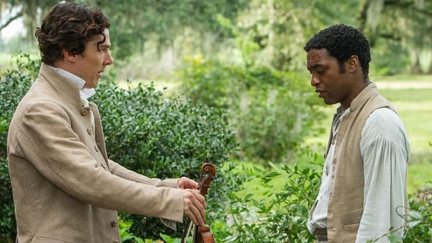 Benedict Cumberbatch, left, and Chiwetel Ejiofor, who is nominated for best male lead in a film, appear in a scene from the slavery drama 12 Years a Slave.