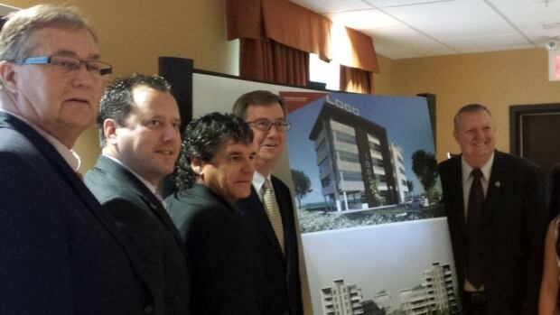 Ottawa councillors Rainer Bloess (far left) and Bob Monette (far right) joined mayor Jim Watson in unveiling Brigil's porposed multi-use complex.
