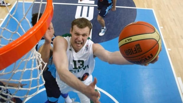 Lithuania's Martynas Pocius, centre, challenges for the ball with Bosnia's Nihad Djedovic during their EuroBasket European Basketball Championship Group B match in Podmezakla Arena, in Jesenice, Slovenia on Monday.