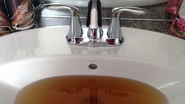 The city has so far refused 52 claims for laundry damaged by the city's brown water. Discoloured water regularly comes out of the tap at Bob Borsa's brand new home in Transcona.