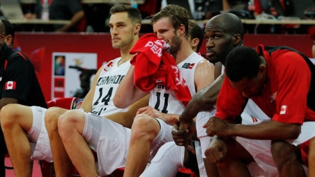 Aaron Doornekamp, centre, reacts on his team's bench moments before Canada's loss against Argentina Sunday.