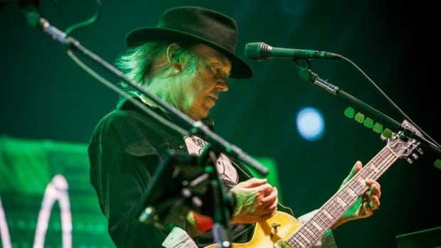 Neil Young, seen performing in Oslo, Norway, on Aug. 7, has compared the oilsands in Fort McMurray to 'a wasteland'.