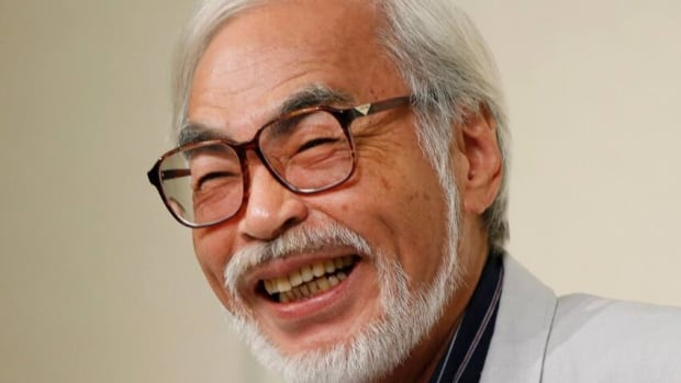 Hayao Miyazaki smiles during a press conference on his retirement in Tokyo on Friday. He said that at age 72 he wants to do other things besides slaving away over his drawings to meet feature film deadlines.