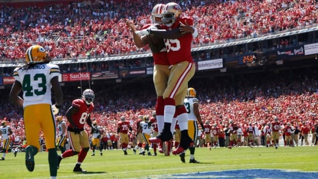 San Francisco 49ers quarterback Colin Kaepernick celebrates with tight end Vernon Davis after a touchdown in the niners' comeback win on Sunday.