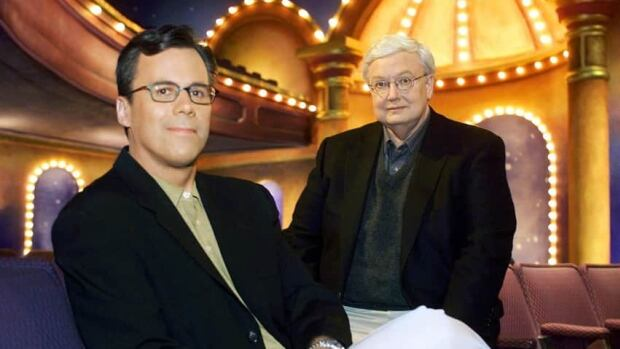 Richard Roeper, left, will succeed the late Roger Ebert as film critic for the Chicago Sun-Times. The two are seen here in a 2000 promotional picture for their program Ebert and Roeper at the Movies.