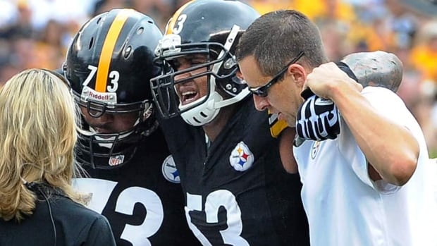 Pittsburgh Steelers centre Maurkice Pouncey (53) is helped from the field after being injured in the first quarter against the Tennessee Titans on Sunday.