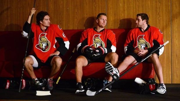 Ottawa Senators' Mark Stone, left, Mark Methot, centre, and Bobby Ryan wait to pose for a TV portrait as they report to the first day of training camp in Ottawa on Wednesday.