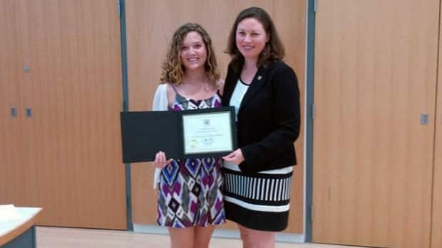 Jessica Del Rosso receives a women's leadership award from Kitchener-Waterloo MPP Catherine Fife in May 2013. Del Rosso was forced to leave her family home as a teenager for her sexual orientation.