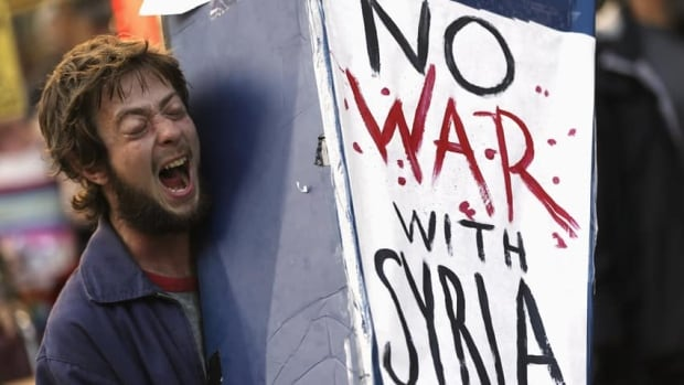 A demonstrator in San Francisco chants in opposition to the proposed military intervention against Syria, days after U.S. President Barack Obama said he was willing to take military action against Syria even without allied support.