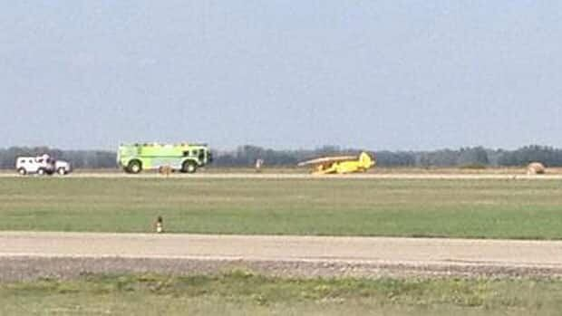 Emergency crews tend to the scene of a plane crash at the Brandon airport on Tuesday.