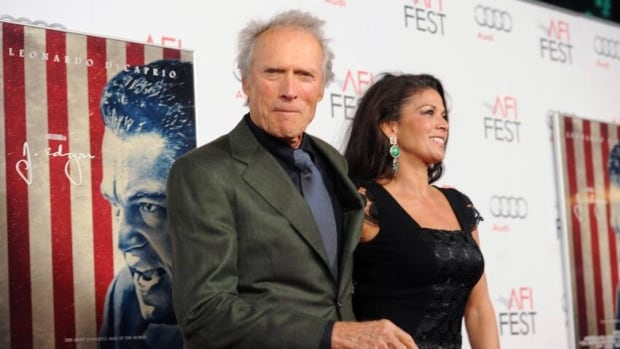Director Clint Eastwood and Dina Eastwood arrive at the J. Edgar opening night gala on November 3, 2011 in Hollywood.