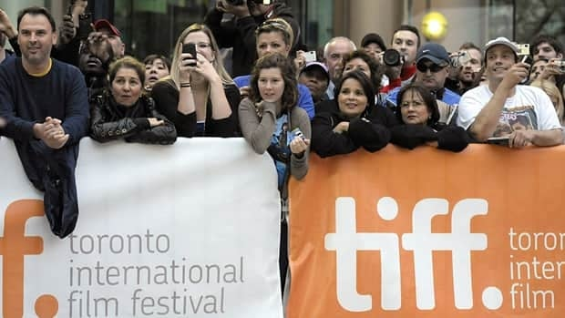 Fans watch as celebrities arrive at the Toronto International Film Festival opening night premiere of the feature film Score: A Hockey Musical in Toronto on Thursday, Sept. 9, 2010.