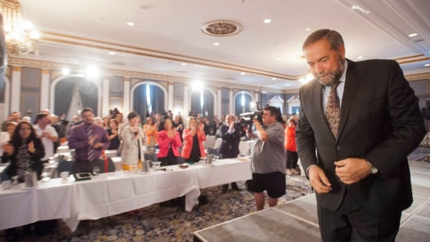 NDP leader Tom Mulcair leaves the stage after he addresses party members at a national caucus strategy session Wednesday in Saskatoon. The province's federal ridings have been redrawn, creating some urban seats in neighbourhoods seen as more friendly to the New Democrats.