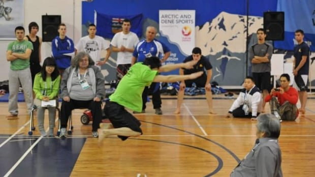 An athlete performs a kneel jump at the 2012 Arctic Winter Games in Whitehorse. The host society for the 2014 games in Fairbanks, Alaska, is in the midst of its volunteer recruiting drive.