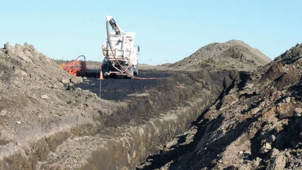 A vacuum truck cleans up oil near Tioga, N.D. on Oct. 8. The North Dakota Health Department says more than 20,000 barrels of crude oil have spewed out of a Tesoro Corp. oil pipeline in a wheat field in the northwestern part of the state.