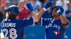 Toronto Blue Jays slugger Edwin Encarnacion, right, will be back in the Blue Jays' lineup along with teammate Colby Rasmus, left, on Friday night against the Baltimore Orioles.