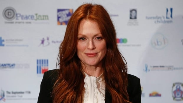 Julianne Moore arrives at the Annual Charity Day hosted by Cantor Fitzgerald and BGC Partners, on Wednesday in New York.