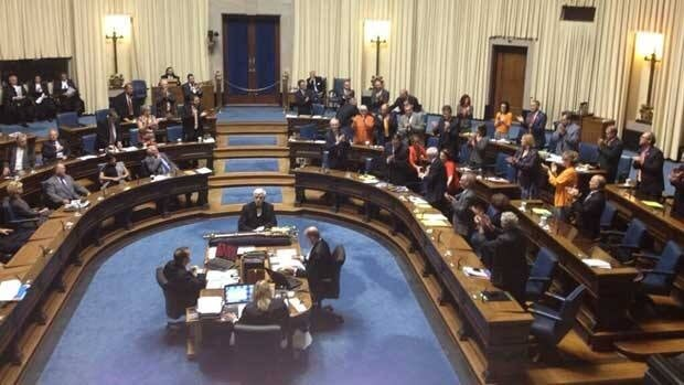 NDP MLAs applaud as Bill 18 passes the final vote in the legislature late Friday afternoon.