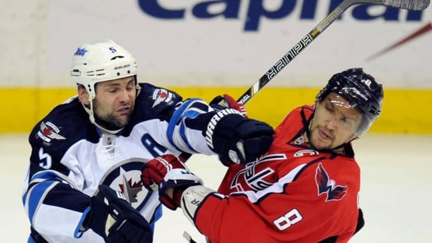 The Jets' Mark Stuart, left, and Capitals captain Alex Ovechkin, right, could come face-to-face again on Saturday night at Yardmen Arena in Belleville, Ont., as part of Kraft Hockeyville celebrations hosted by the township of Stirling-Rawdon.