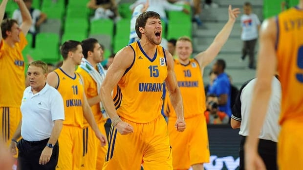 Ukraine's Viacheslav Kravtsov, centre, celebrates with teammates after beating Serbia in their EuroBasket second-round match at the Stozice Arena in Ljubljana on Friday.