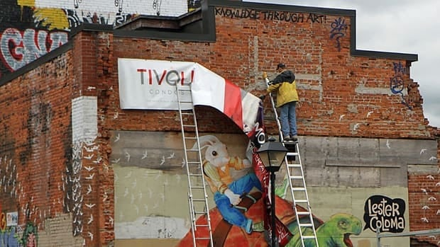 A banner announcing the new Tivoli Theatre condo project was unveiled Friday morning.