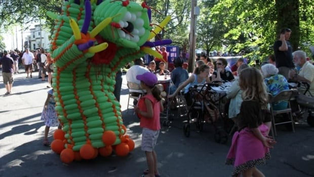 A balloon monster entertains a group of children and their families during Natal Day celebrations in Halifax on Aug. 5, 2013.