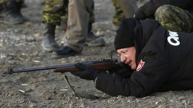 Prime Minister Stephen Harper shoots a .303 Lee Enfield rifle while taking part in a demonstration by the Canadian Rangers at a camp near Gjoa Haven, Nunavut, in 2013. The federal government has asked Colt Canada to find a designer for a new rifle for the Canadian Rangers, to replace the Lee-Enfields purchased in 1947.