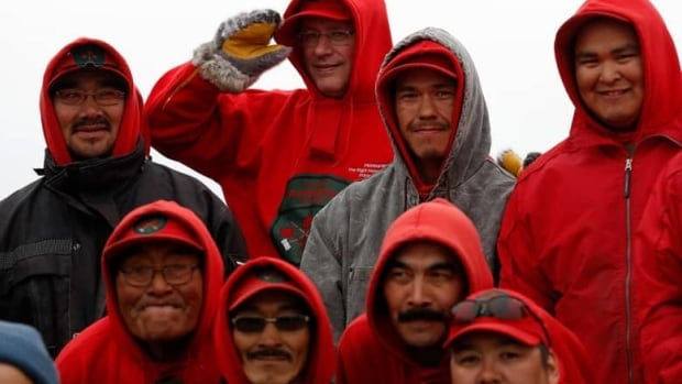 Members of the Canadian Rangers pose with the prime minister at a camp near the Arctic community of Gjoa Haven, Nunavut, during Stephen Harper's 2014 northern tour.