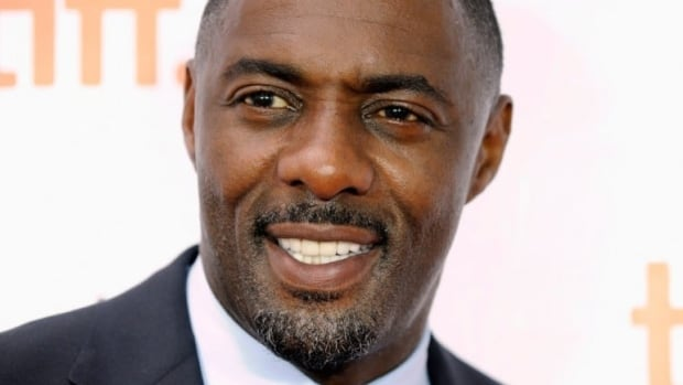 Actor Idris Elba poses on the red carpet before a screening of the film Mandela: Long Walk to Freedom.