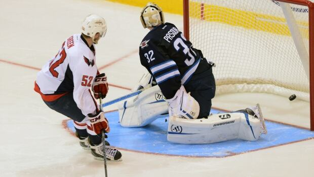 Washington Capitals defenceman Mike Green scores the 4-3 winning goal in the shootout Saturday against Winnipeg Jets goalie Edward Pasquale in the Kraft Hockeyville game on CBC's Hockey Night in Canada.