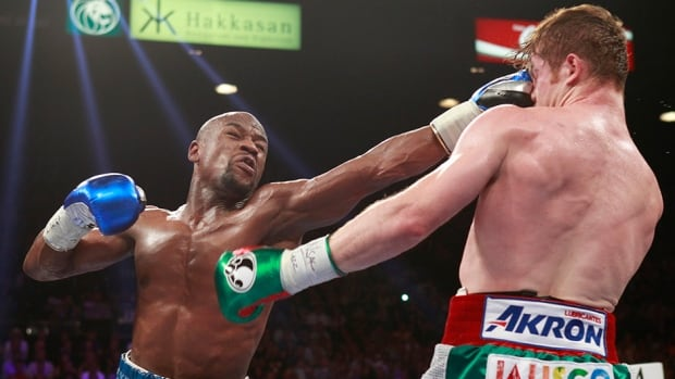 Floyd Mayweather Jr., left, remained unbeaten in 45 fights and added another piece of the junior middleweight title to his collection after defeating Canelo Alvarez on Saturday.