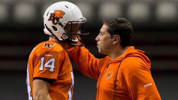 B.C. Lions quarterback Travis Lulay, left, and head coach Mike Benevides talk during the game against the Hamilton Tiger-Cats in Vancouver on August 30, 2013.