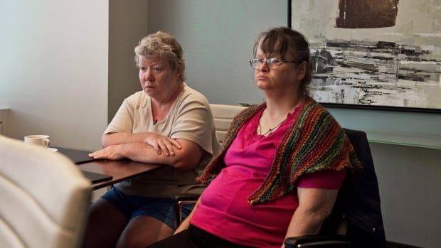 Patricia Seth, left, and Marie Slark, former Huronia Regional Centre residents and plaintiffs in the class action proceeding against the Ontario government, are shown in Toronto on Wednesday, Sept. 11, 2013.