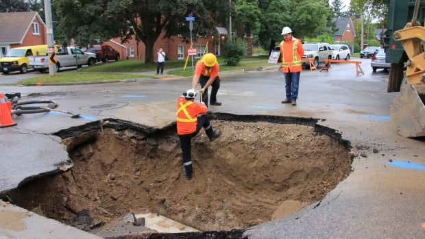 This sinkhole at the intersection of Mill and Heiman streets in Kitchener was created in September 2013 by a water main break.