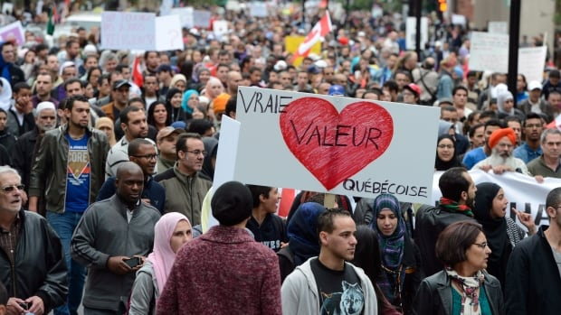 Demonstrators take part in a protest against Quebec's proposed Values Charter in Montreal on Saturday Sept. 14, 2013.