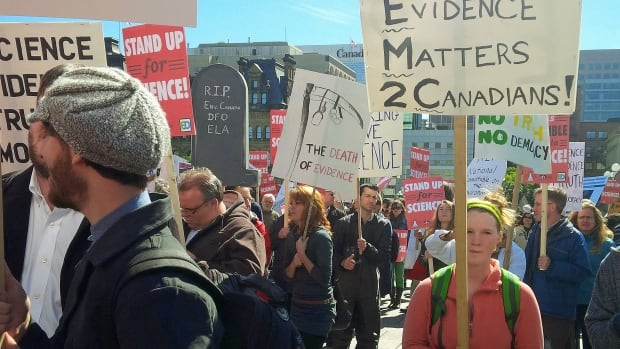Scientists gathered on Parliament Hill in Ottawa and at locations across the country to protest cuts to research and what they say are the federal government's attempts to 'muzzle' scientists.